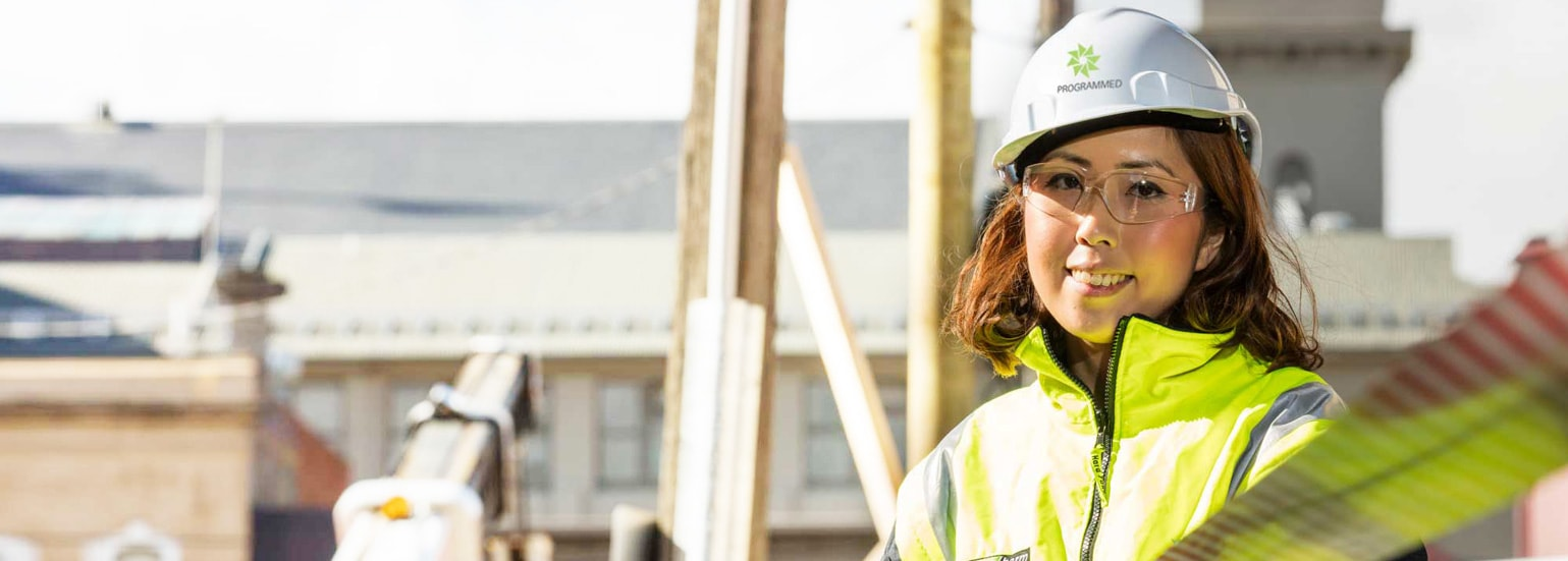 Programmed Lady with hard hat and safety glasses